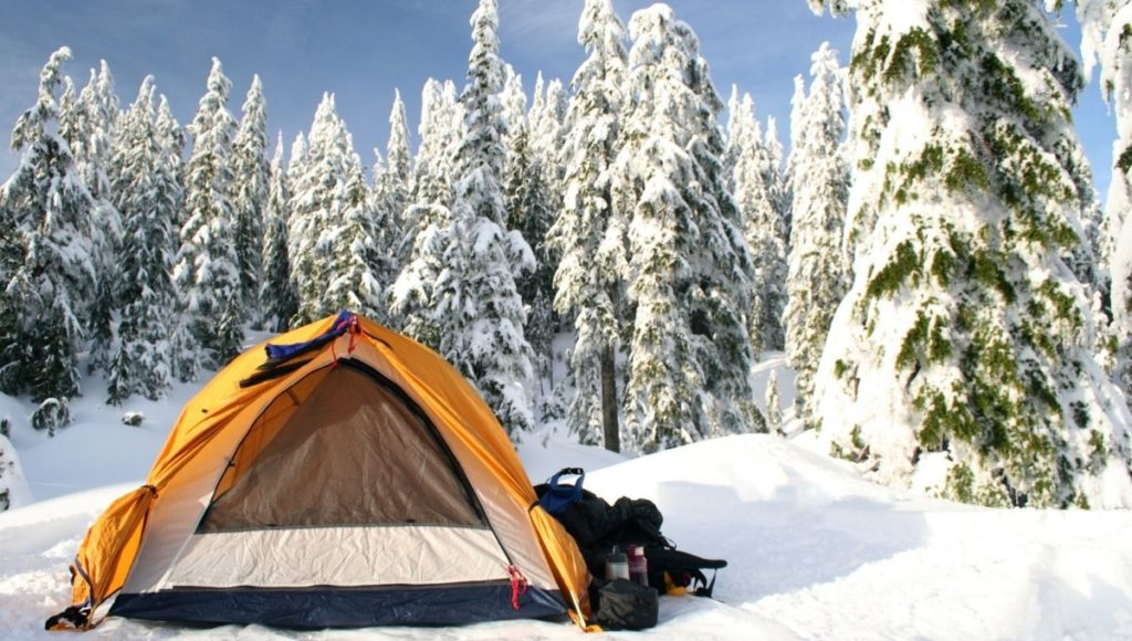 A tent set up on snowy cold ground