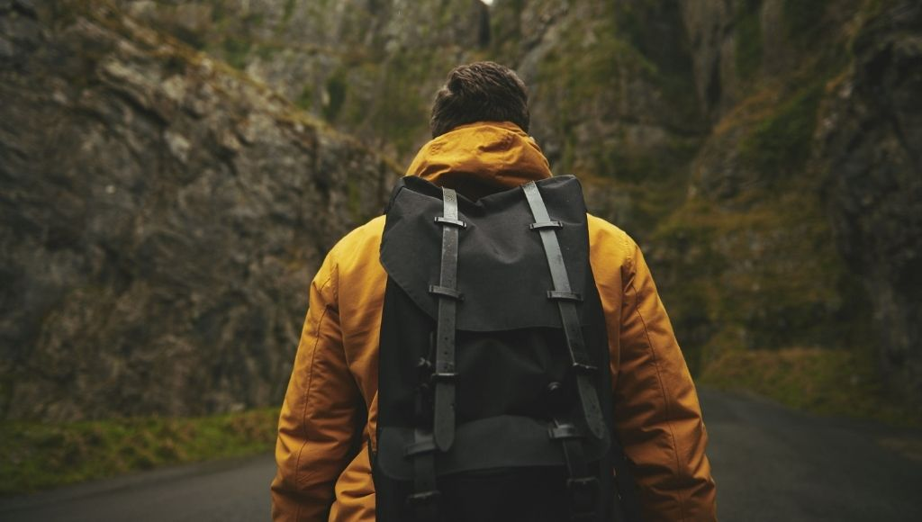 A man with backpacker in mountain trek