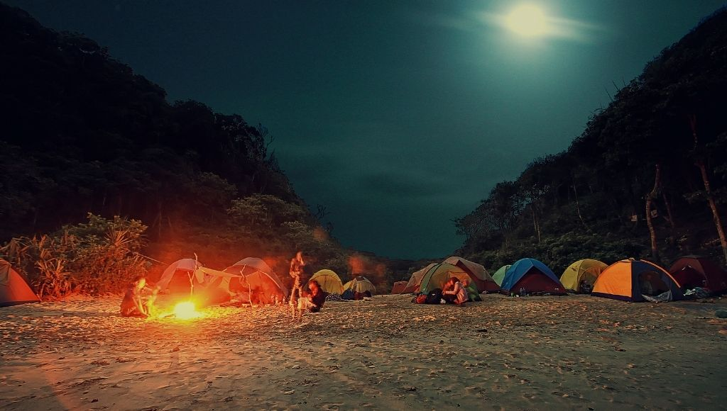 A view of some people campfire outside of their camping