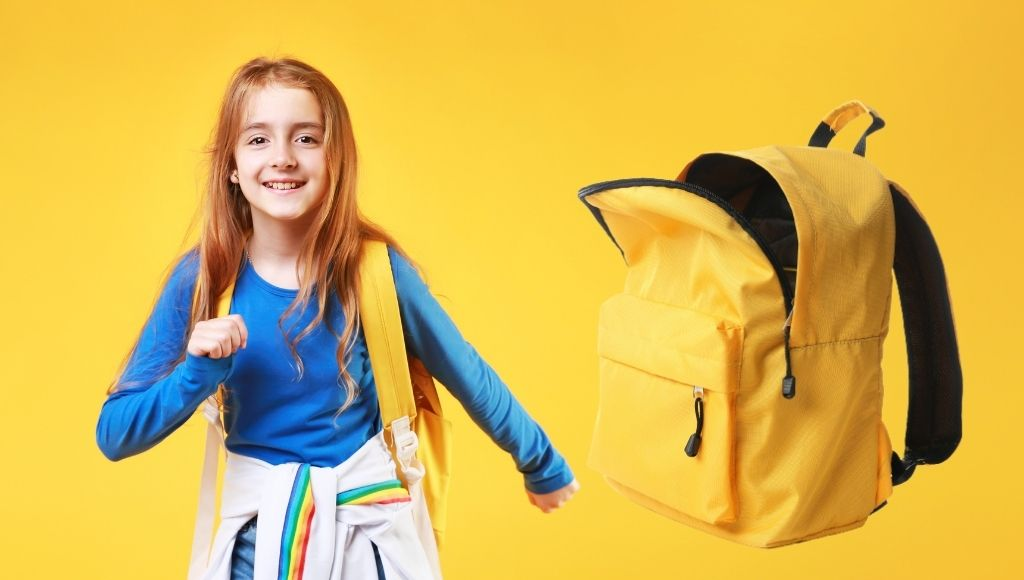 Schoolchild running with an empty backpack