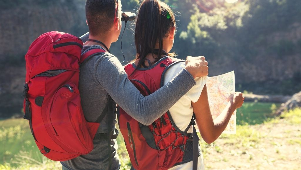 A couple with Venture Pal Backpack and Daypack