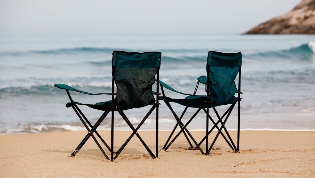 Kingcamp Camping Chair and STRONGBACK Elite Chairs Standing side by side On the beach