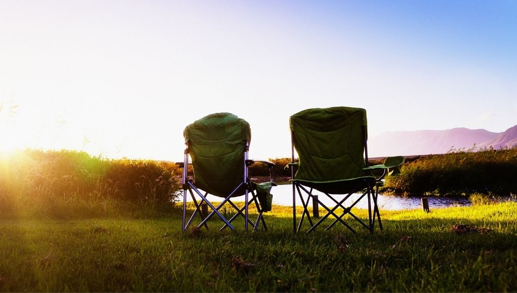 Kingcamp Camping Chair and STRONGBACK Elite Chair staying in a Lakeside