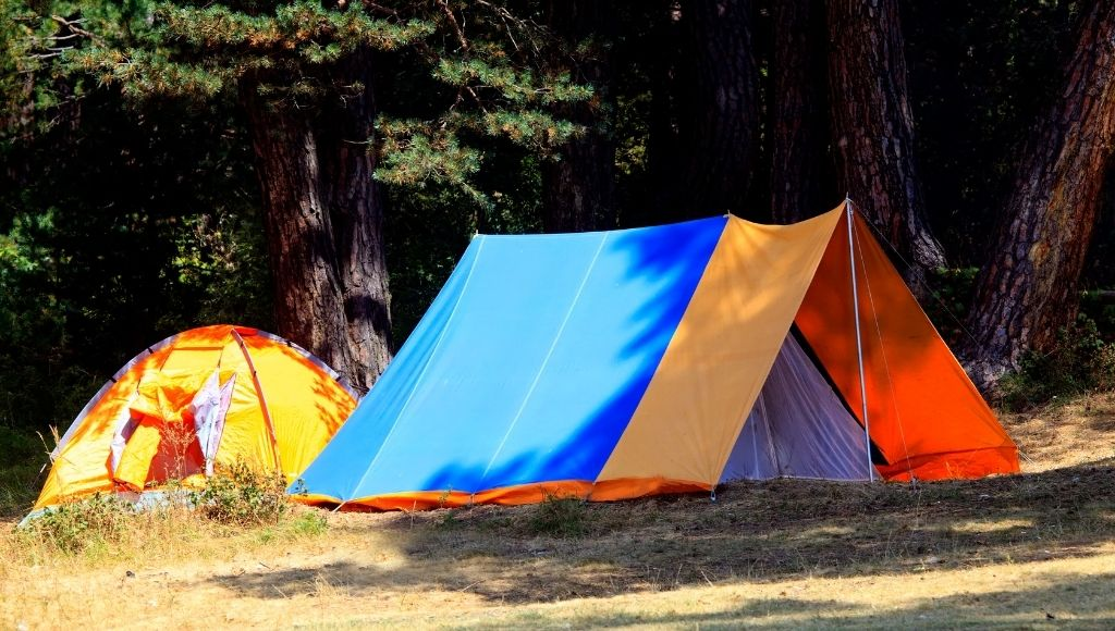 A scenario of the tarps over top of the tents